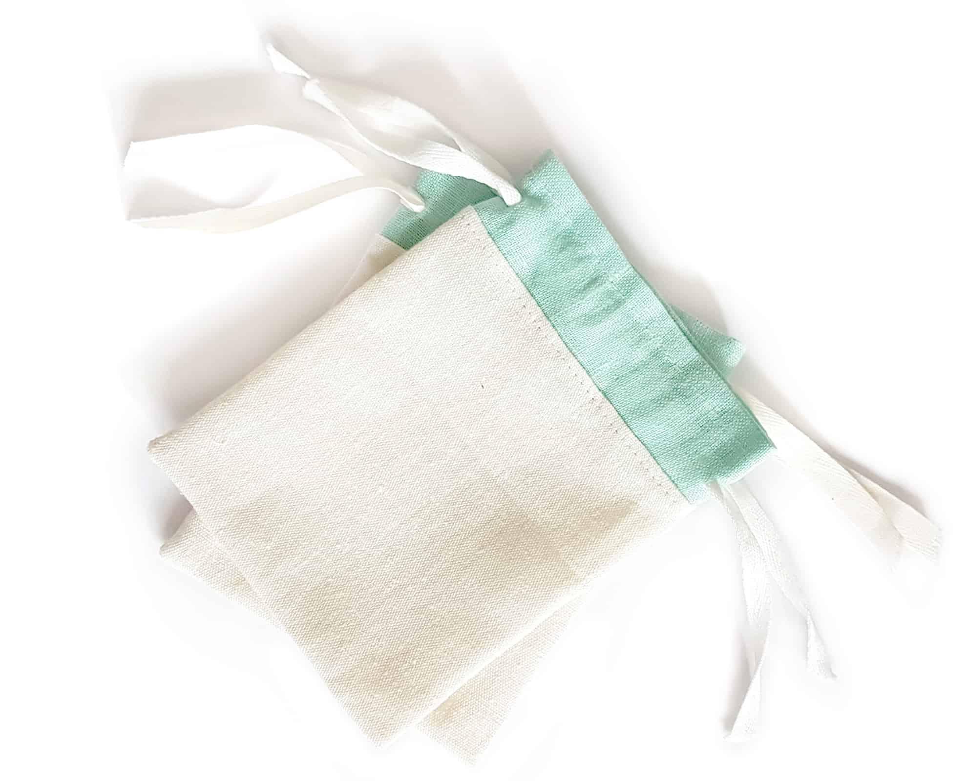 Biało miętowy lniany woreczek na prezenty dla gości weselnych