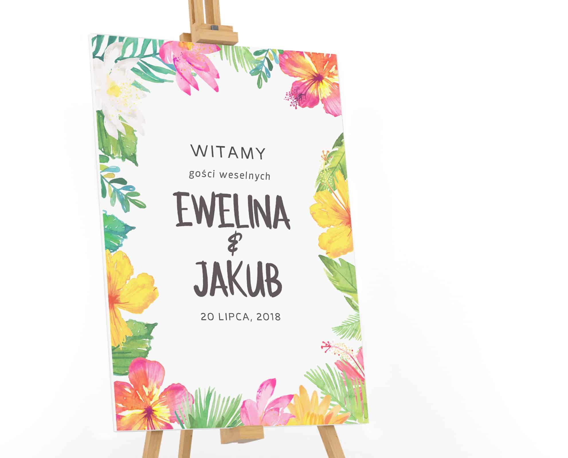 Tablica powitalna dla gości weselnych z tropikalnymi kwiatami