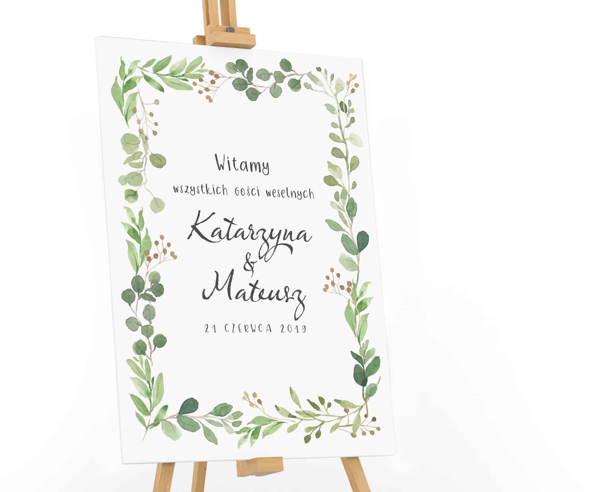 Tablica powitalna dla gości weselnych z zielonymi listkami w stylu watercolor
