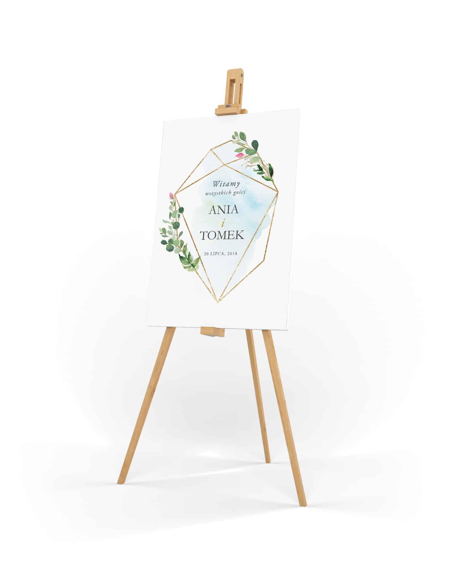 Tablica powitalna na wesele z akwarelowym niebieskim tłem i geometrycznym wzorem