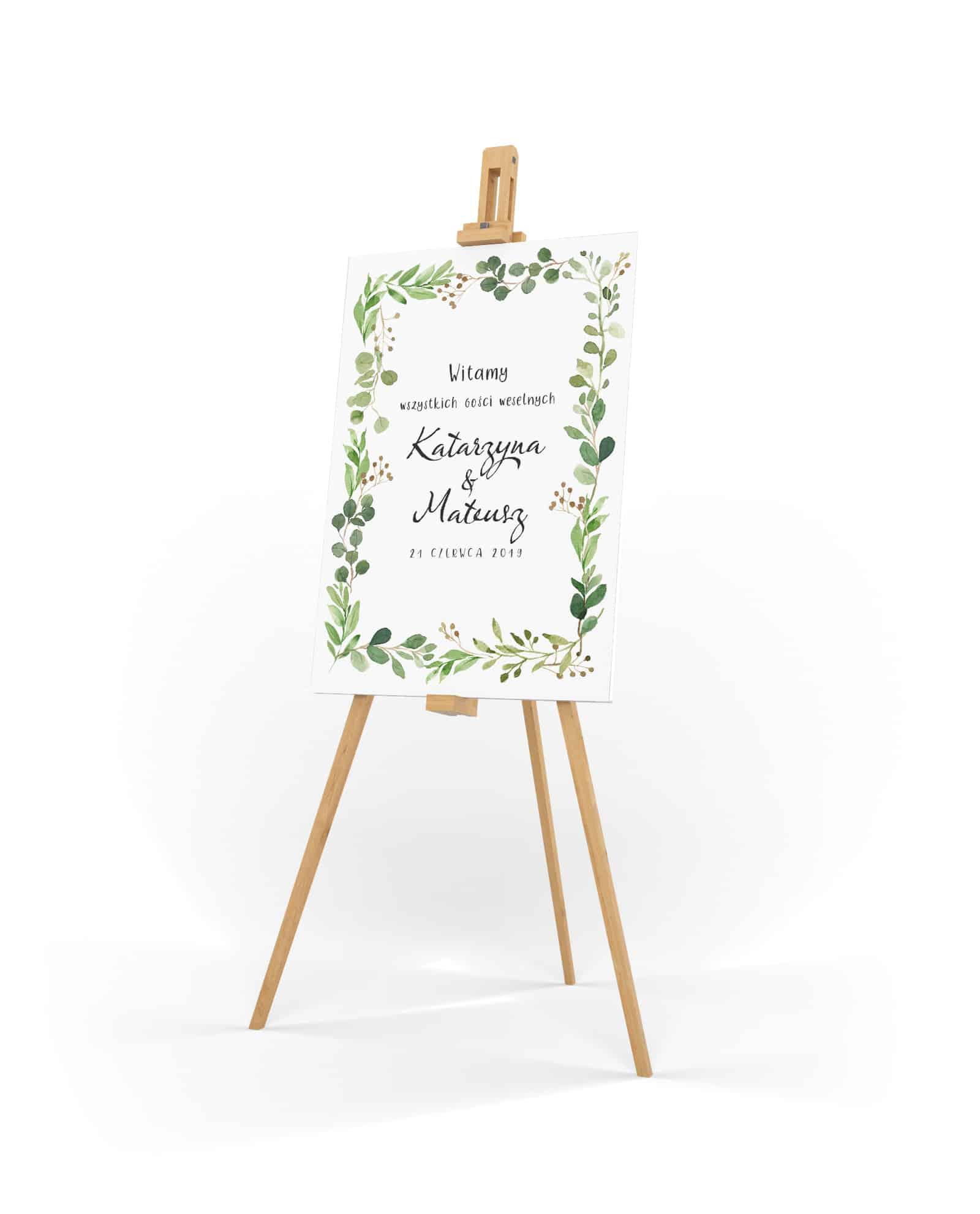 Tabica powitalna na wesele z zielonymi listkami dookoła imion
