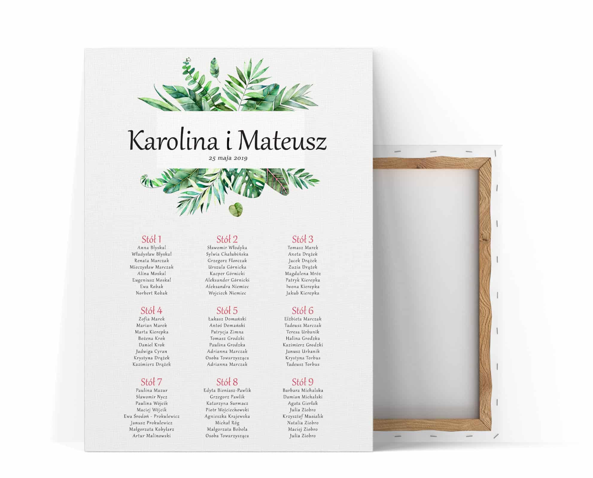Tablica stołów na wesele z dużymi liściami monstery