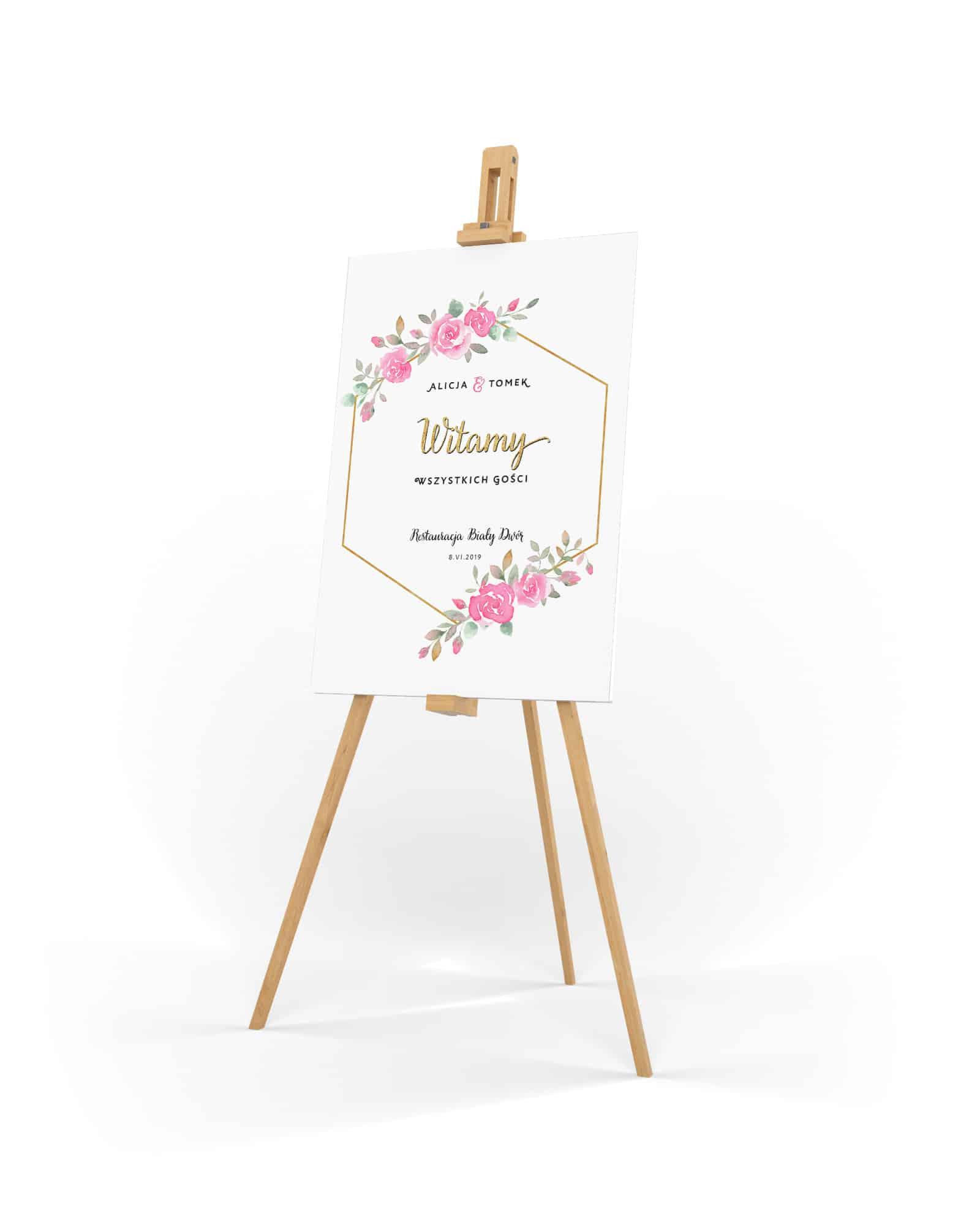 Tablica powitalna z różowymi różami i złotą ramką