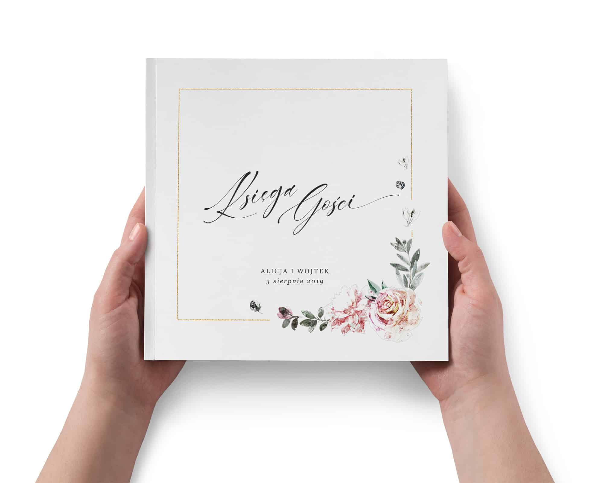 Księga gości weselna z pięknymi kwiatami i złotą ramką