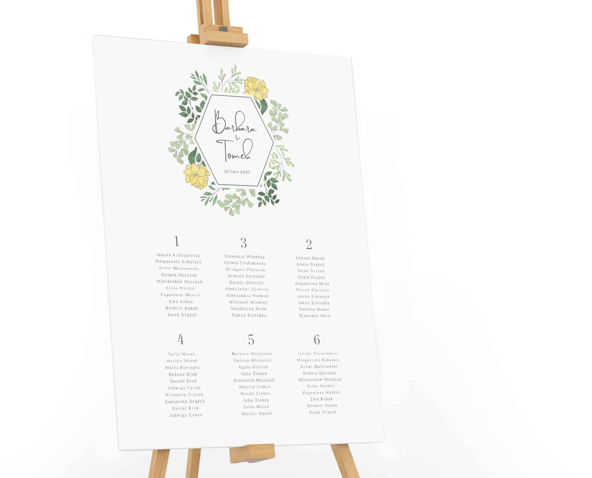 Plan stołów w stonowanych kolorach zieleni, z listkakami dookoła imion
