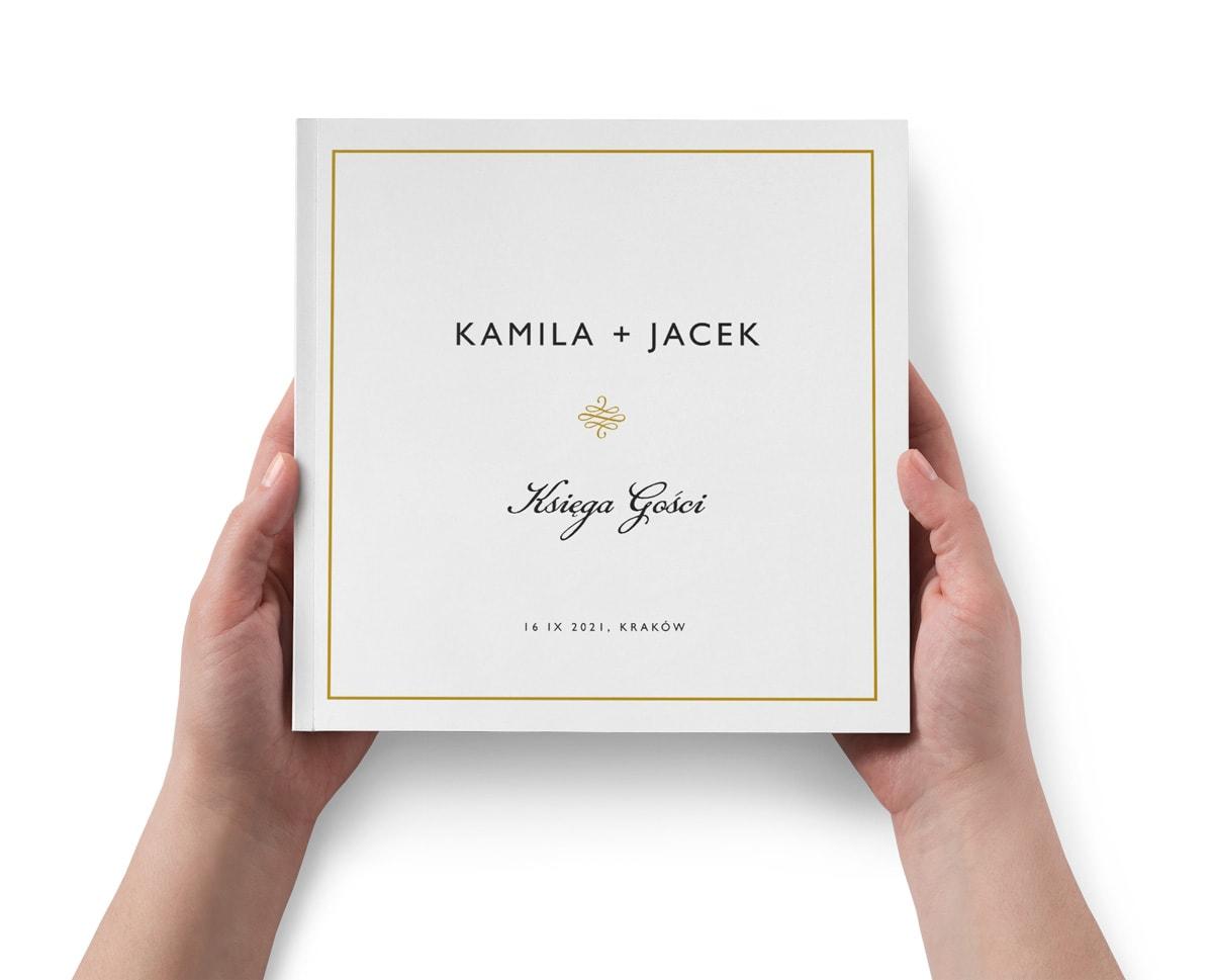 Elegancka biała księga w minimalistyczej formie ze złotą ramką glamour