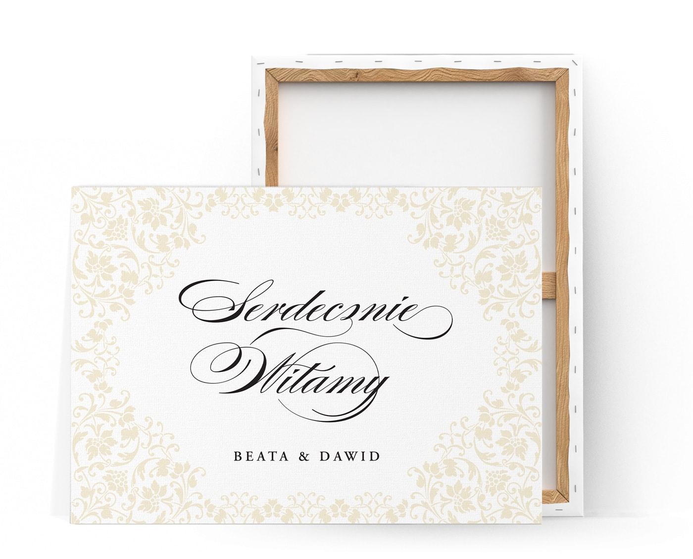 Tablica powitalna z kaligrafowanym napisem serdecznie witamy w otoczeniu ornamentów