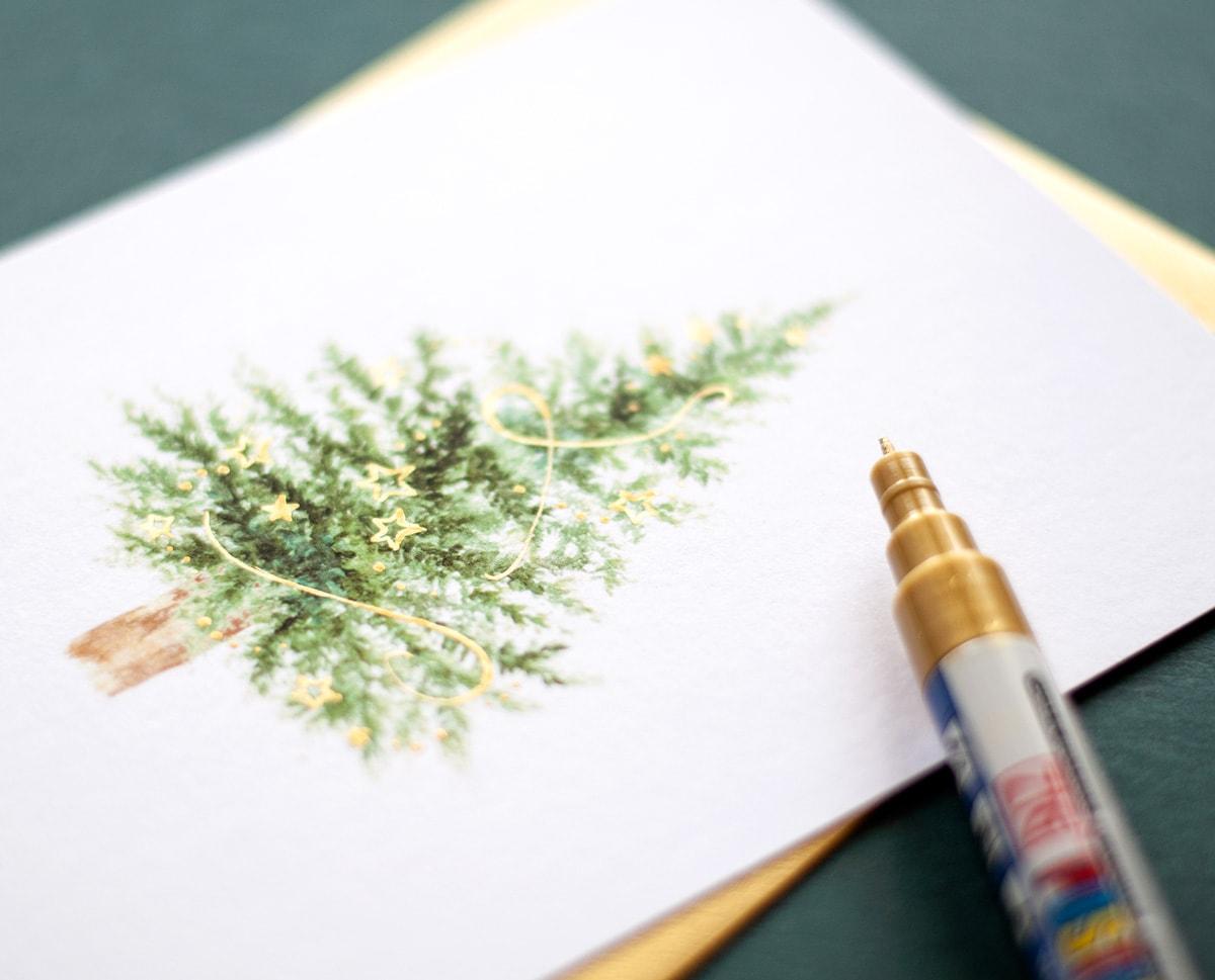 Kartka świąteczna z choinką zdobioną złotymi gwiazdkami