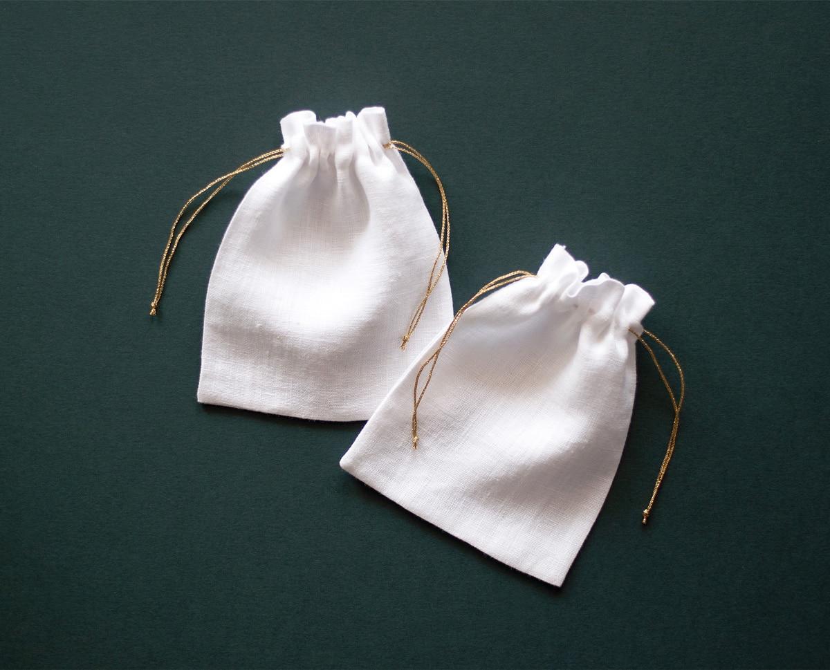 Lnianie woreczki, białe ze złotym sznureczkiem