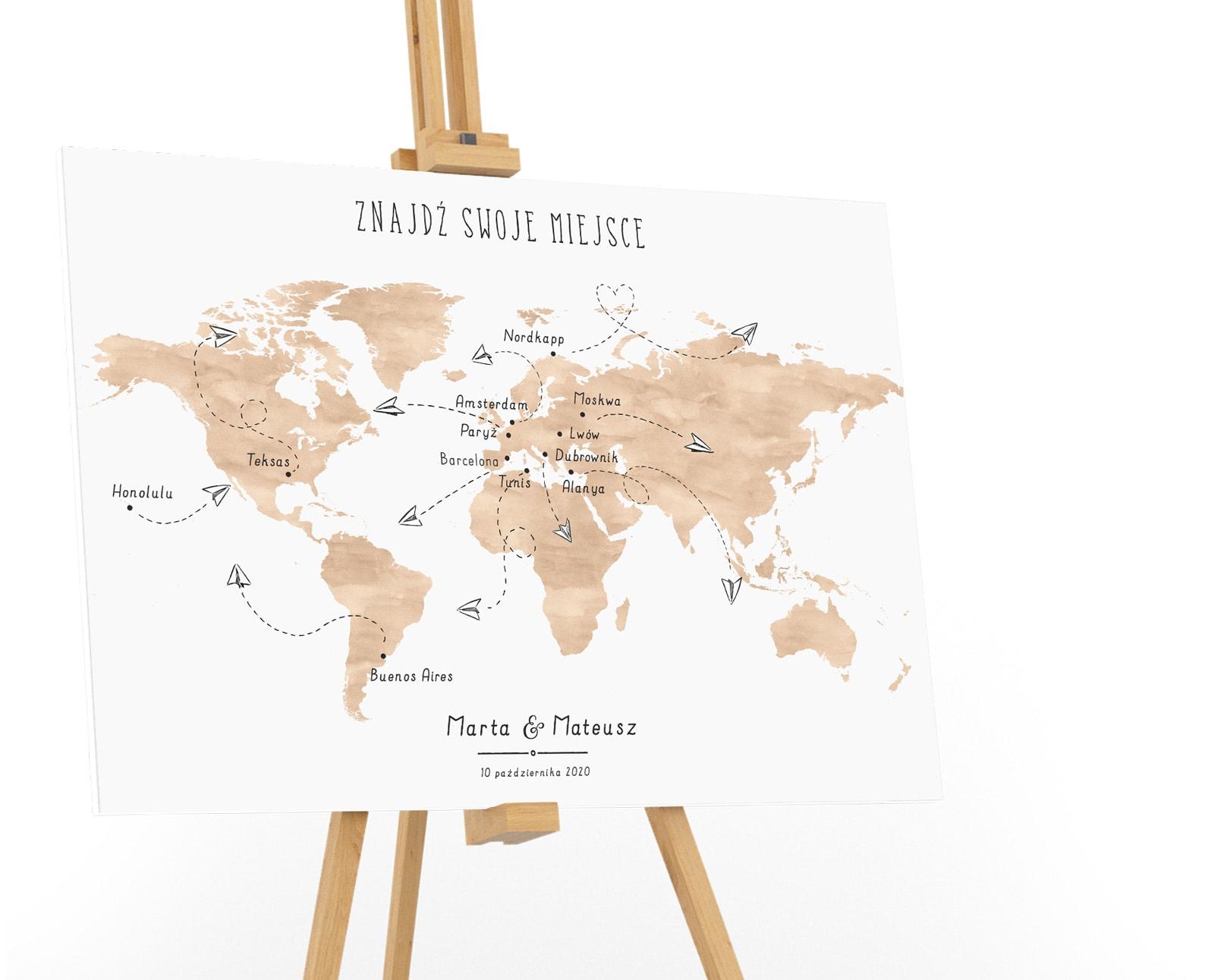 Tablica powitalna z mapą świata i lecącymi samolocikami z papieru