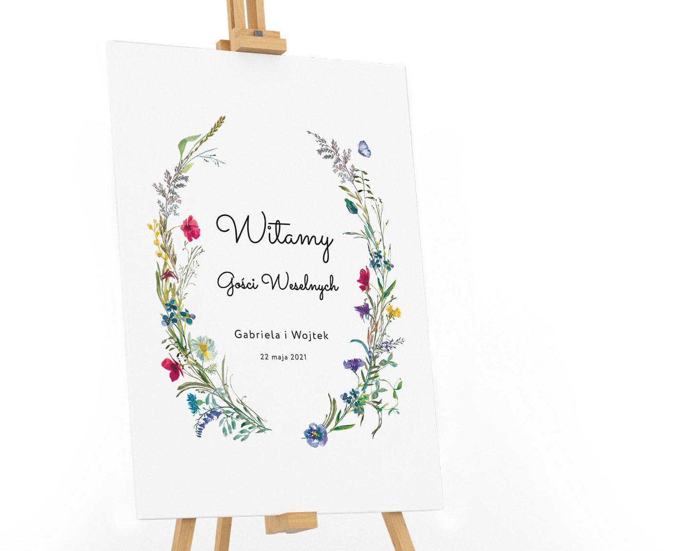 tablica powitalna z motywem polnych kwiatów