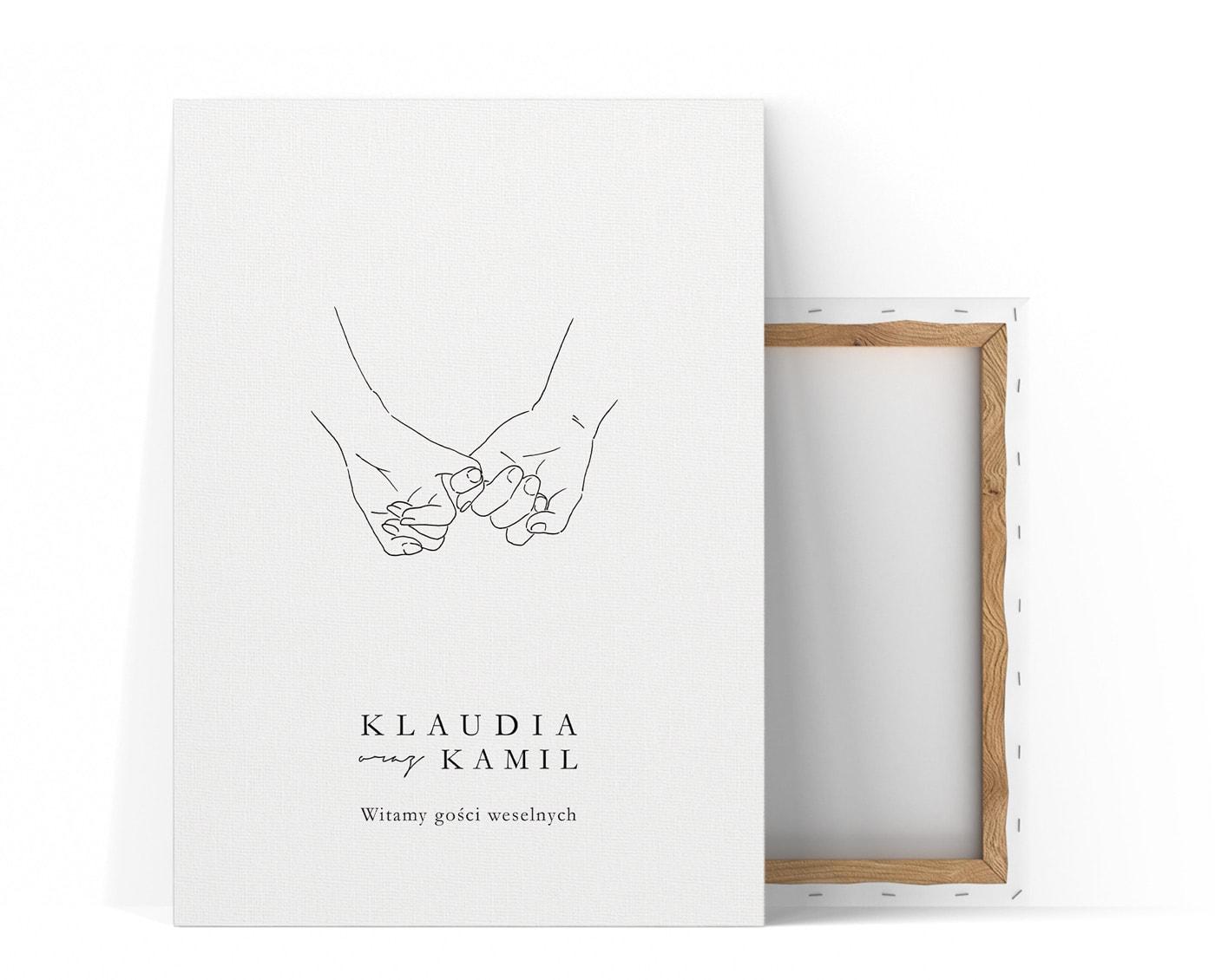 Tablica powitalna z rysunkiem dłoni trzymających się za małe palce